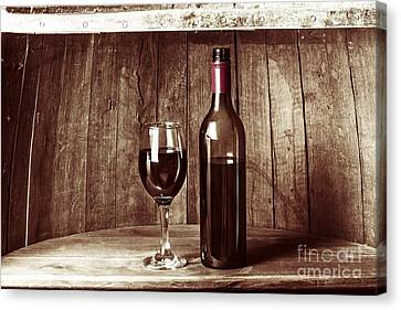 Vintage Red Wine In Old Winery Cellar Barrel  Canvas Print by Jorgo Photography - Wall Art Gallery