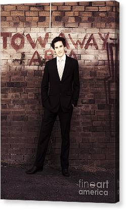 Vintage Salesman Standing In Front Of Brick Wall Canvas Print by Jorgo Photography - Wall Art Gallery