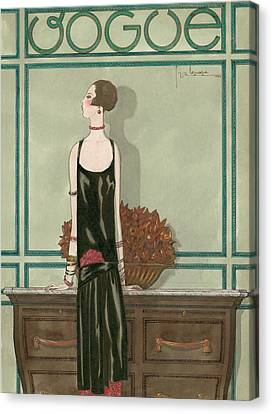 Vogue Magazine Cover Featuring A Woman Wearing Canvas Print by Georges Lepape
