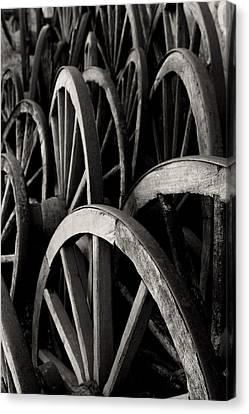 Wagon Wheels Canvas Print by John Nelson
