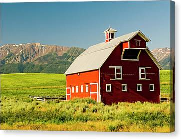 Wallowa Mountains And White Barn Canvas Print