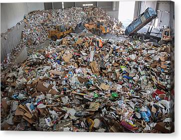 Waste Arriving At A Recycling Centre Canvas Print by Peter Menzel