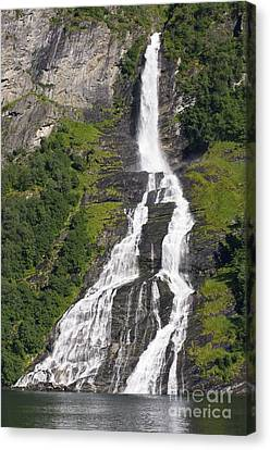 Waterfall In A Fjord, Norway Canvas Print by Dr Juerg Alean