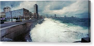 Waves Splashing Into The Malecon Canvas Print