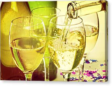 White Wine Pouring Into Glasses Canvas Print by Colin and Linda McKie