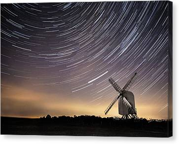 Windmill On A Starry Night. Canvas Print by Ian Hufton