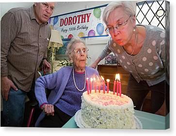 Woman Celebrating 100th Birthday Canvas Print by Jim West