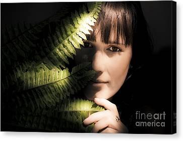 Woman Hiding Behind Fern Leaf Canvas Print by Jorgo Photography - Wall Art Gallery