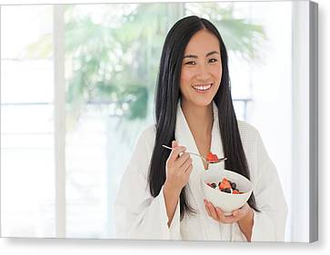 Woman Holding Bowl Of Fruit Canvas Print