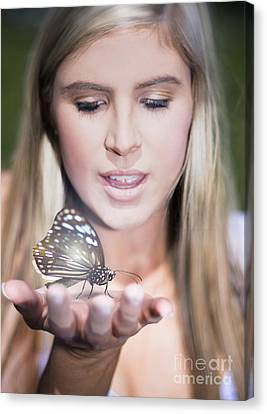 Woman Holding Butterfly Canvas Print