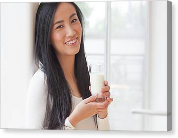 Woman Holding Glass Of Milk Canvas Print by Ian Hooton
