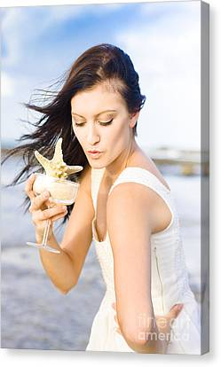 Woman Holding Star Fish Cocktail Canvas Print by Jorgo Photography - Wall Art Gallery