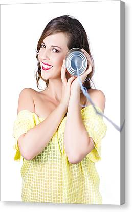 Woman Listening With Tin Can Phone To Ear Canvas Print by Jorgo Photography - Wall Art Gallery