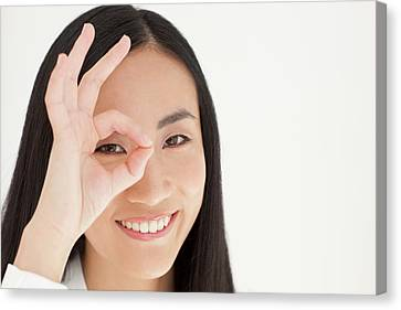 Chinese Ethnicity Canvas Print - Woman Looking Through Fingers by Ian Hooton