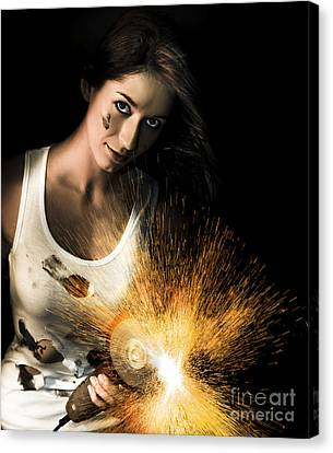 Woman With Angle Grinder Spraying Sparks Canvas Print by Jorgo Photography - Wall Art Gallery