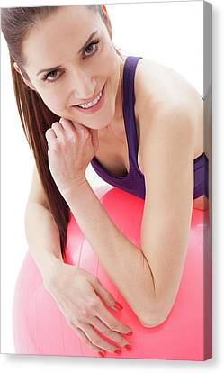 Woman With Fitness Ball Canvas Print by Ian Hooton