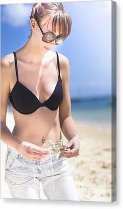 Woman With Starfish On Beach Canvas Print