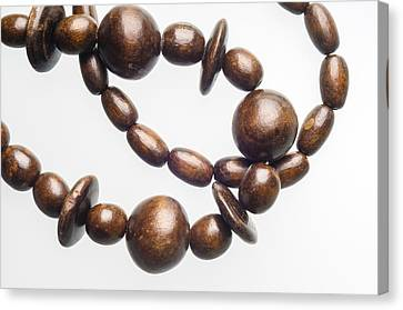 Wooden Beads Necklace Canvas Print by Alain De Maximy