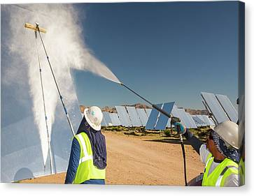 Workers Washing The Heliostats Canvas Print by Ashley Cooper