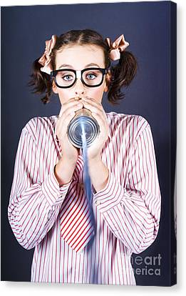 Young Businesswoman Talking On Homemade Can Phone Canvas Print by Jorgo Photography - Wall Art Gallery