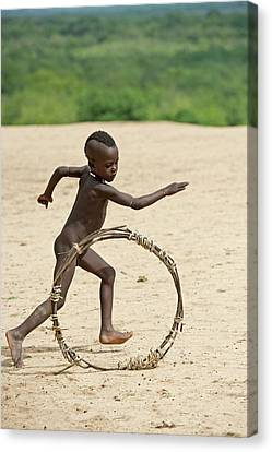 Young Karo Boy With Home Made Toy Hoop Canvas Print by Tony Camacho