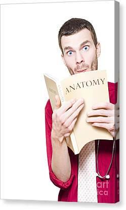 Young Medical Intern Student Studying Anatomy Book Canvas Print
