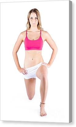 Young Woman Exercising Canvas Print by Jorgo Photography - Wall Art Gallery
