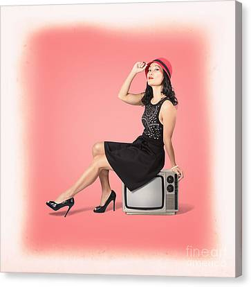 Young Woman Sitting On Old Tv Set Canvas Print by Jorgo Photography - Wall Art Gallery