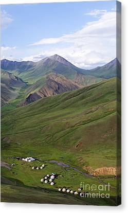Yurts In The Tash Rabat Valley Of Kyrgyzstan  Canvas Print