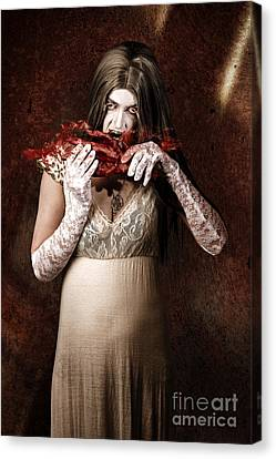 Zombie Vampire Woman Eating Human Hand Canvas Print by Jorgo Photography - Wall Art Gallery