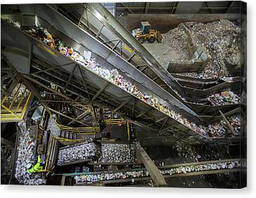 Waste Sorting At A Recycling Centre Canvas Print by Peter Menzel