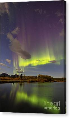 Aurora Borealis With Moonlight At Fish Canvas Print by Joseph Bradley