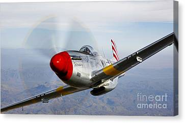A P-51d Mustang In Flight Canvas Print by Scott Germain