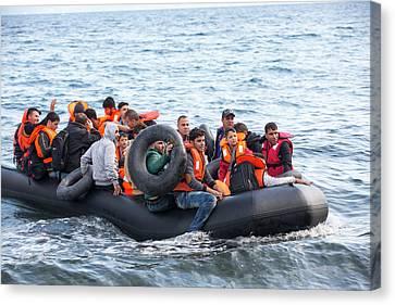 Syrian Refugees Arriving On Greek Island Canvas Print