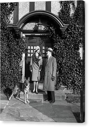 Dog At Door Canvas Print - 1920s Couple Wearing Coat Hat Gloves by Vintage Images