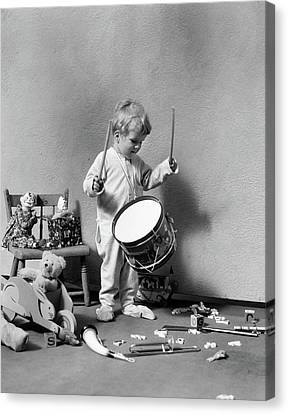 Drummer Canvas Print - 1930s Boy In Pajamas Beating On Toy by Vintage Images