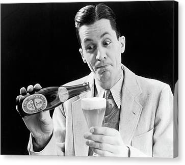 Anticipation Canvas Print - 1930s Man Pouring Beer From Bottle by Vintage Images