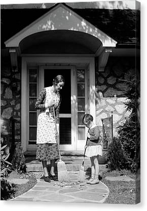 Caring Mother Canvas Print - 1930s Mother And Daughter Sweeping by Vintage Images
