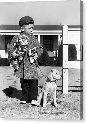 Anticipation Canvas Print - 1940s Boy With Puppy On Leash Holding by Vintage Images
