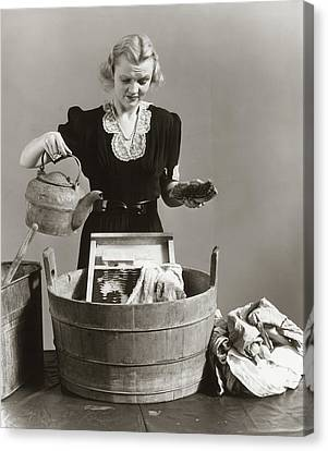 Wash Tubs Canvas Print - 1940s Displeased Housewife Pouring by Vintage Images