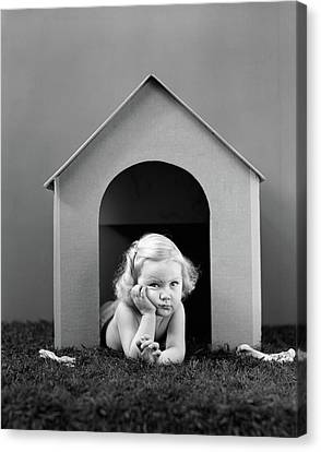 Punishment Canvas Print - 1940s Girl In Doghouse Lying On Grass by Vintage Images