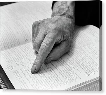 Aging Canvas Print - 1940s Hand Of Elderly Man Reading Bible by Vintage Images