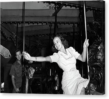 Wood Carving Canvas Print - 1940s Smiling Woman On Carousel by Vintage Images
