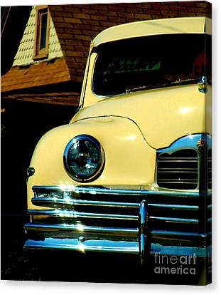 Canvas Print featuring the photograph 1950 Yellow Packard by Janette Boyd