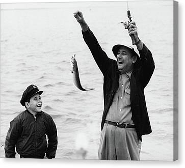 Old Grandfather Time Canvas Print - 1950s 1960s Boy Son Fishing With Man by Vintage Images