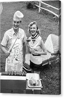 Chaise Canvas Print - 1950s 1960s Couple Backyard Grilling by Vintage Images