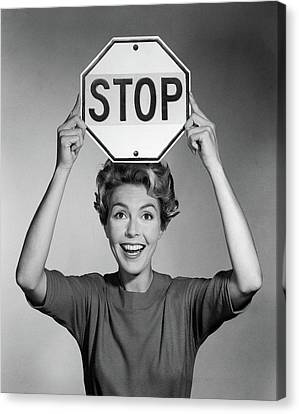 Stop Signs Canvas Print - 1950s 1960s Smiling Woman Holding Stop by Vintage Images