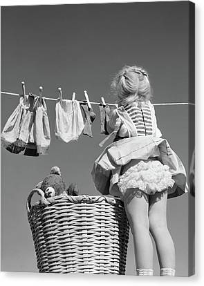 Laundry Canvas Print - 1950s Back View Of Girl Hanging Laundry by Vintage Images
