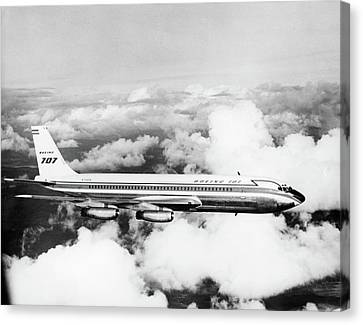 Passenger Plane Canvas Print - 1950s Boeing 707 Passenger Jet Flying by Vintage Images