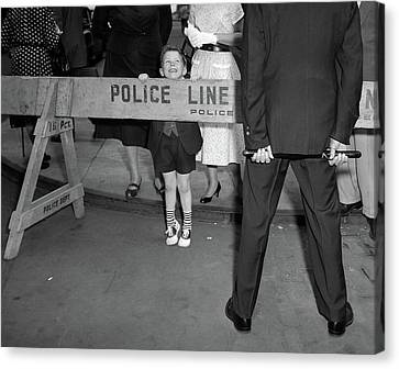 Police Canvas Print - 1950s Boy Looking Over Police Barricade by Vintage Images